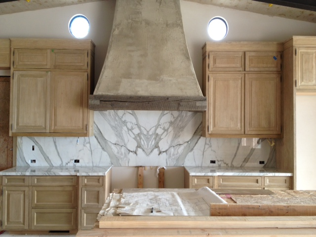 Here is a shot of the kitchen after the installing the marble on the  countertops and backsplash. The great thing about marble is that the  veining creates ...